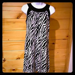 Adorable sleeveless zebra patterned slip on dress
